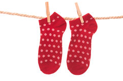 Red socks hanging on a rope clothesline Royalty Free Stock Photography
