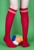 Red socks long legs and football Stock Photo