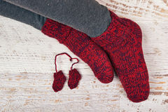 Red Socks. Mother's red wool socks and small copy for expected baby Stock Photos
