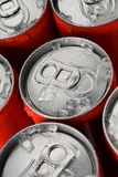 Red soda cans. Group of red aluminum soda or cola cans in ice with water droplets Stock Photos