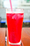 Red soda syrup mixture. Stock Photo