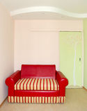 Red sofa. In a modern living room Royalty Free Stock Photo