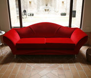 Red sofa. Nice red Italian couch in livingroom Royalty Free Stock Image
