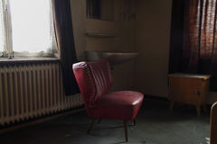 Red sofa. In an abandoned hostel Stock Photo