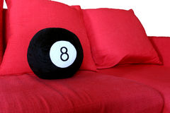 Red sofa with 8 ball isolated on white background Royalty Free Stock Image