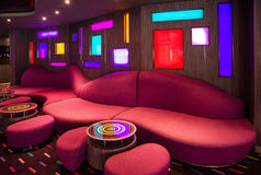 Red sofa in bar modern interior on cruise liner. Stock Photos