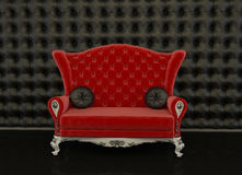 Red sofa on a black background Royalty Free Stock Photography
