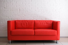 Red sofa and brick wall. Red sofa and white brick wall Stock Images