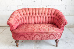 Red sofa couch. In vintage room - classical style royalty free stock photos
