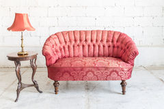 Red sofa couch Stock Photography