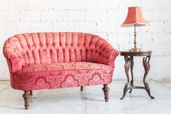 Red sofa couch. In vintage room with lamp - classical style Royalty Free Stock Photography