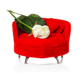 Red sofa, couch with white rose Stock Photo