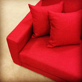 Red sofa with cushions Royalty Free Stock Image