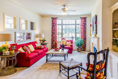 Red Sofa in Decorated Den Stock Images