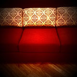 Red sofa with decorative cushions Stock Photography