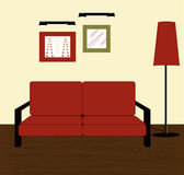 Red sofa and floor lamp Stock Photo