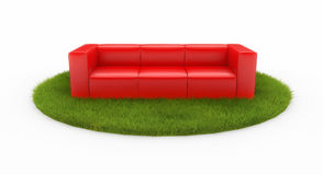 Red sofa on green field Stock Image