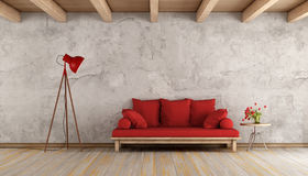 Red sofa in a grunge room Stock Images