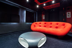Red sofa at home cinema. View of red sofa at home cinema stock photo