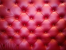Red sofa leather background. Luxury red sofa leather cushion for textured pattern background Stock Images