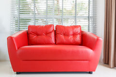 Red sofa in living room Stock Images