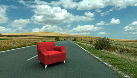 Red sofa in the middle of the road. Red sofa in the middle of a country road Stock Image
