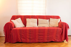 Red sofa in a modern home Royalty Free Stock Image