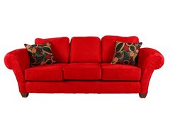 Red sofa with modern pillows