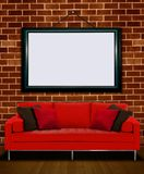 Red sofa with picture frame Stock Photography