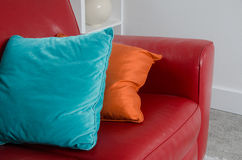 Red Sofa and Pillows. Detail of a red leather sofa accessorized by two complementary pillows Stock Images