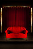 Red sofa on the stage Stock Photos