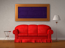 The red sofa, a table and a lamp with a frame Royalty Free Stock Photo