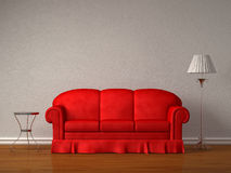 Red sofa with table and stand lamp Royalty Free Stock Photography