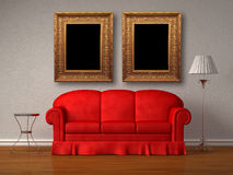 Red sofa with table and stand lamp with frames. In white minimalist interior Stock Image