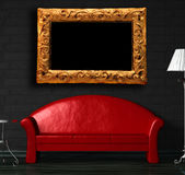 Red sofa, table and standard lamp with frame Stock Images