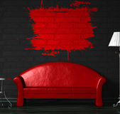 Red sofa, table and standard lamp with splash Stock Photo