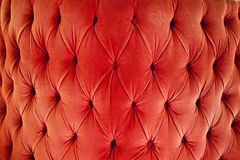 Red sofa upholstery velvet fabric Stock Photography