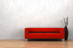 Red sofa and vase in front of white wall Royalty Free Stock Image