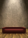 Red sofa on wooden ground Stock Images