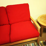 Red sofa and wooden table Stock Images