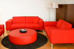 Red sofas. In the living room with lamp stock photos