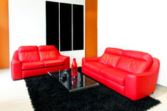 Red sofas. Modern living room with red leather sofas Stock Image