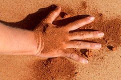 Red soil hand shape on sand like aboriginal art style Royalty Free Stock Photo