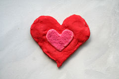Red soil heart. Red heart made mass of soil Royalty Free Stock Photography