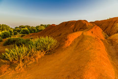 Red soils around the lake in bauxite quarry Royalty Free Stock Photography