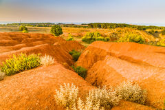 Red soils around the lake in bauxite quarry Stock Images