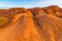 Red soils around the lake in bauxite quarry Royalty Free Stock Image