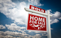 Red Sold Home For Sale Real Estate Sign and Sky Royalty Free Stock Photos