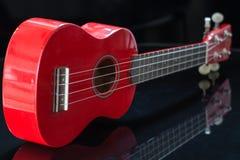 Red soprano ukulele. View of a red soprano ukulele Royalty Free Stock Images