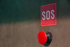 The red SOS button on a gray background Stock Image